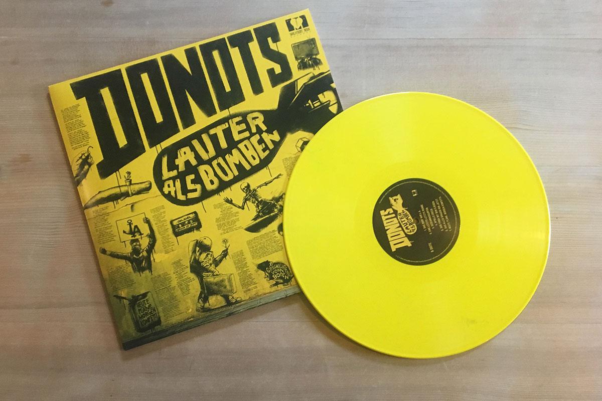 Donots - Lauter als Bomben - Cover mit Platte